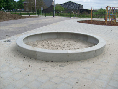 zandbak rond beton